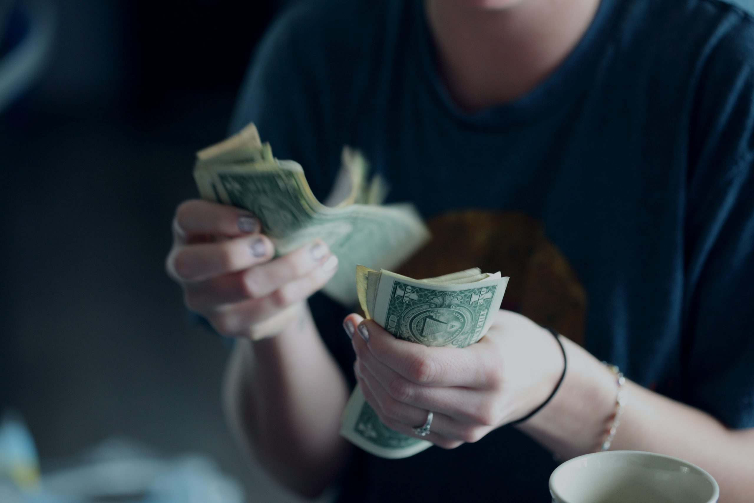 Counting money.