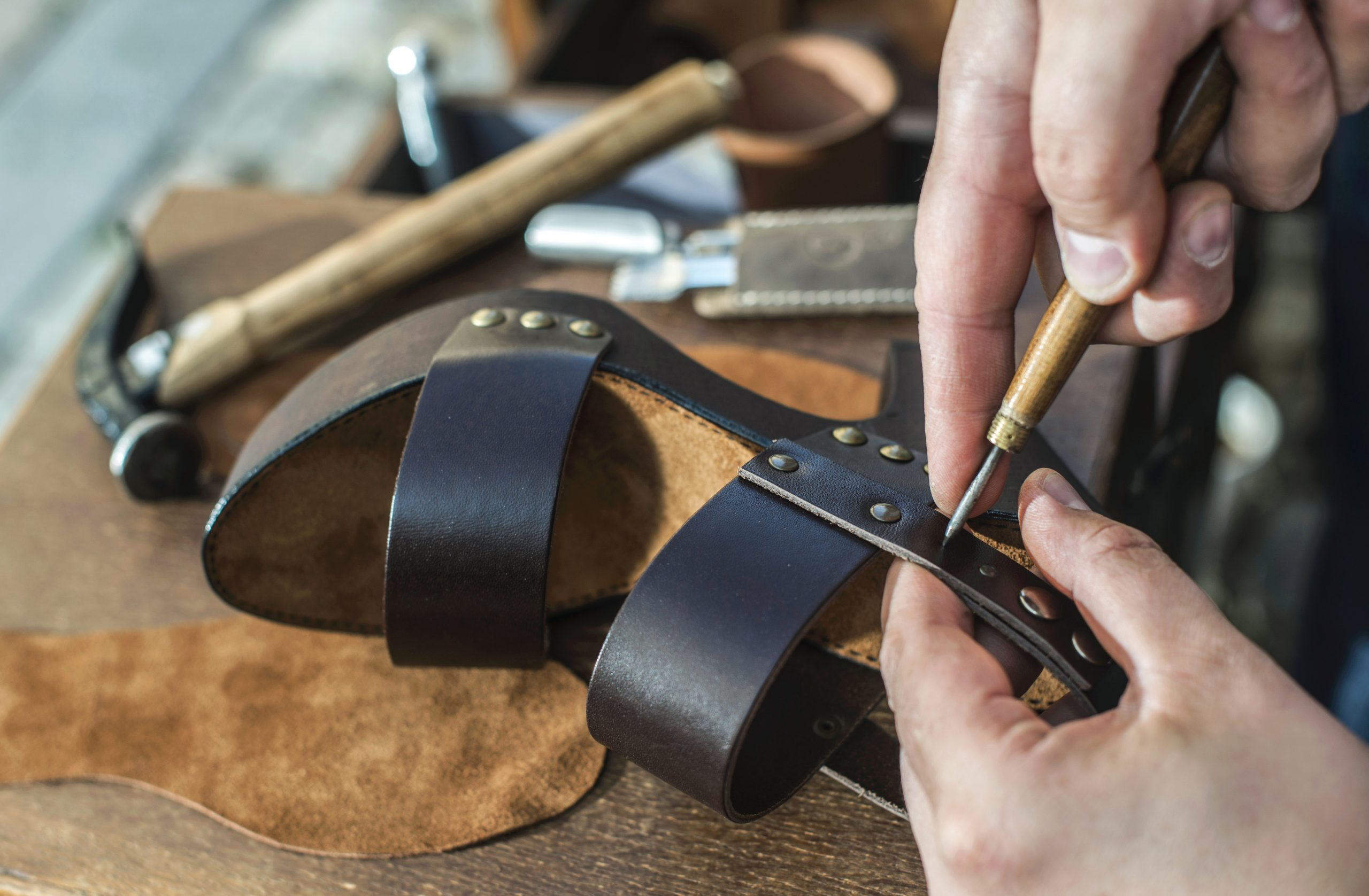 Making shoes.