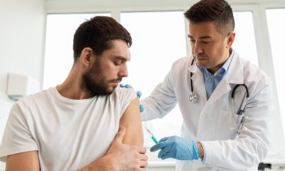 Patient and doctor with syringe doing vaccination.
